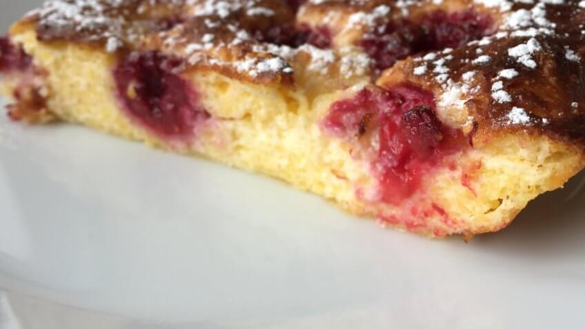 Corn meal pudding with raspberries served